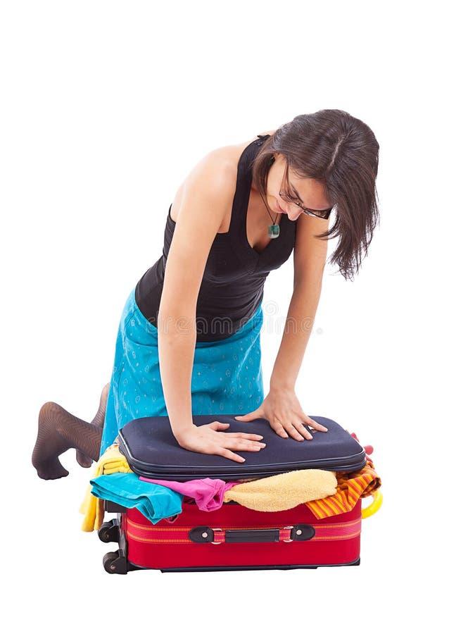 Woman sitting on luggage stock photo