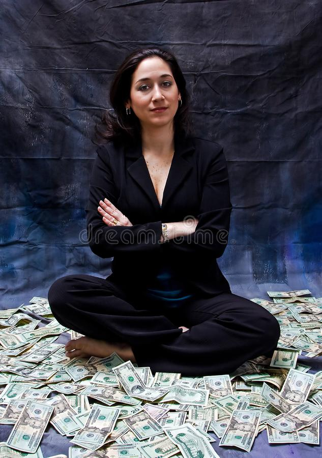 Woman sitting in money royalty free stock photos