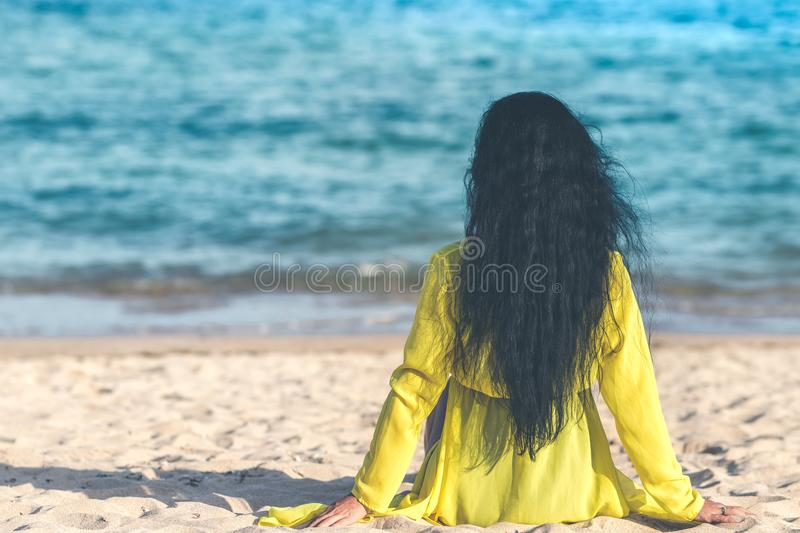 Woman Sitting Near Ocean stock images