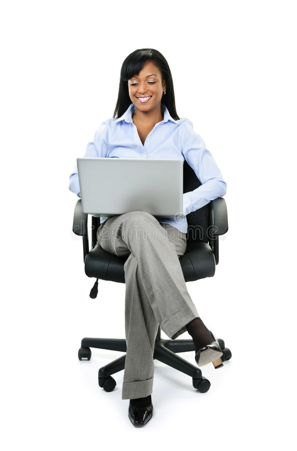 Woman sitting in office chair with computer royalty free stock photos