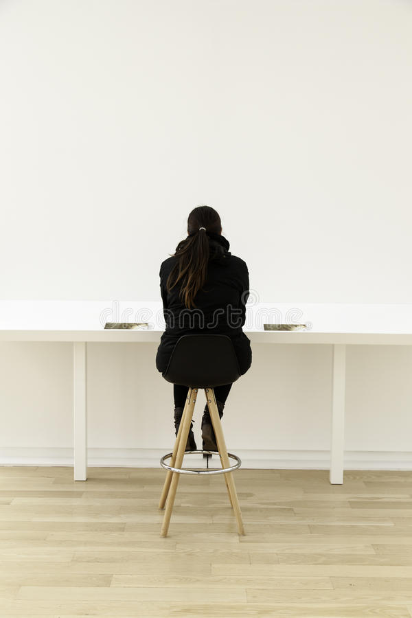 Woman sitting in office royalty free stock image