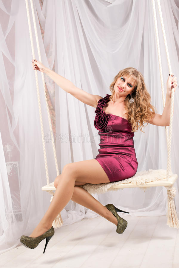 Free Woman Sitting On A Swing Stock Photo - 36517340