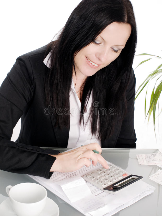Download Woman Sitting With Papers And Calculator Royalty Free Stock Photography - Image: 11340757