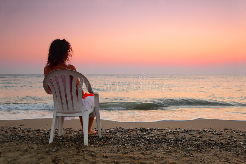 Download Woman Sitting On Plastic Chair On Beach Stock Photo - Image of beach, outdoor: 17888956