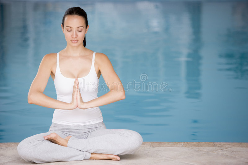 Download Woman Sitting Poolside Doing Yoga Stock Image - Image: 5930603