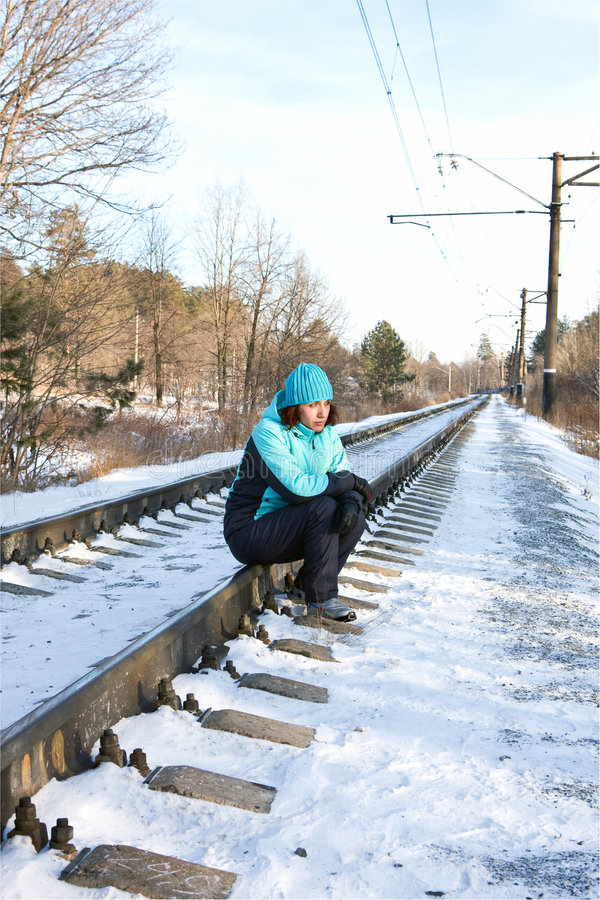 Download The Woman Sitting On Rails Of The Railway Royalty Free Stock Image - Image: 7693056