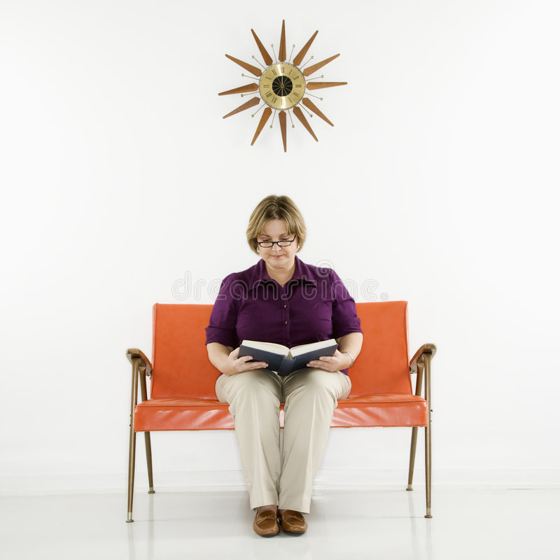 Woman sitting reading book. royalty free stock photos