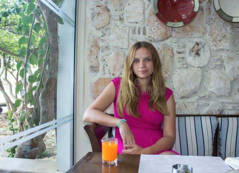 Woman sitting at resort cafe stock image