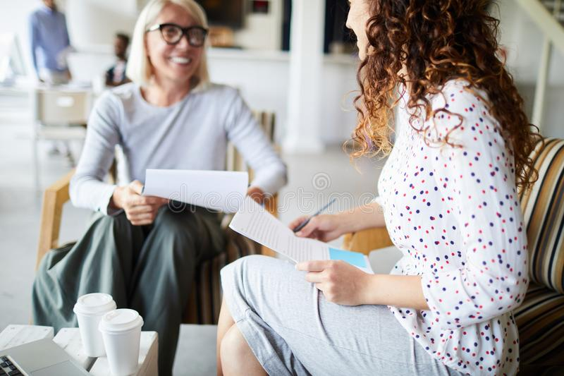 Woman sitting with resume royalty free stock photos