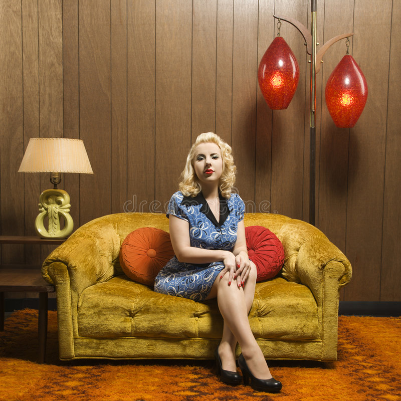 Woman sitting in retro room. royalty free stock photography