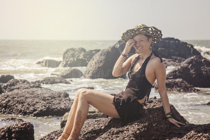 Woman sitting on the rock stock image