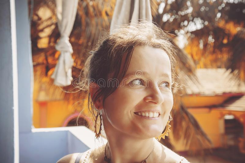 Woman sitting in rooftop restaurant stock image