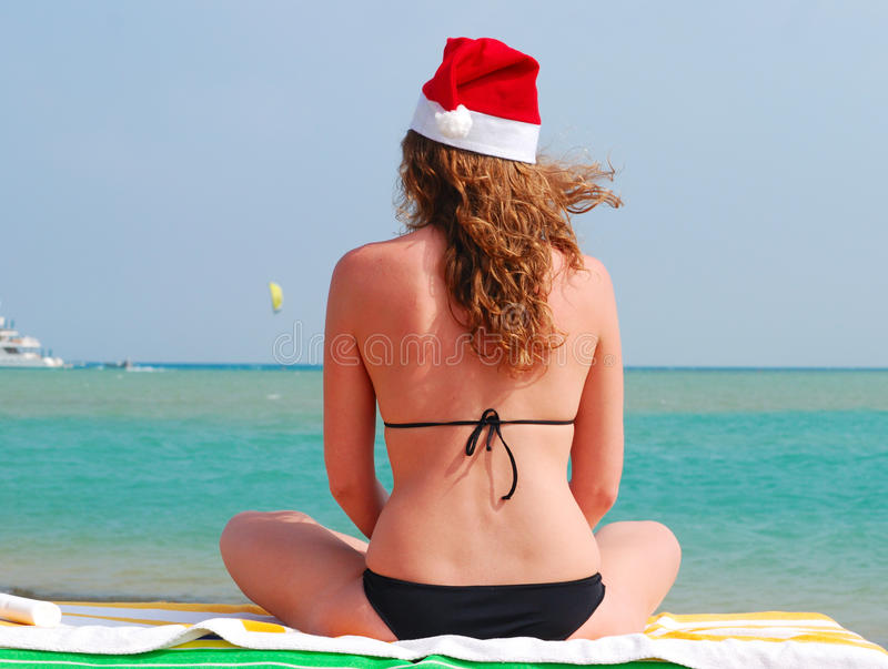 Woman is sitting in santa hat royalty free stock photo