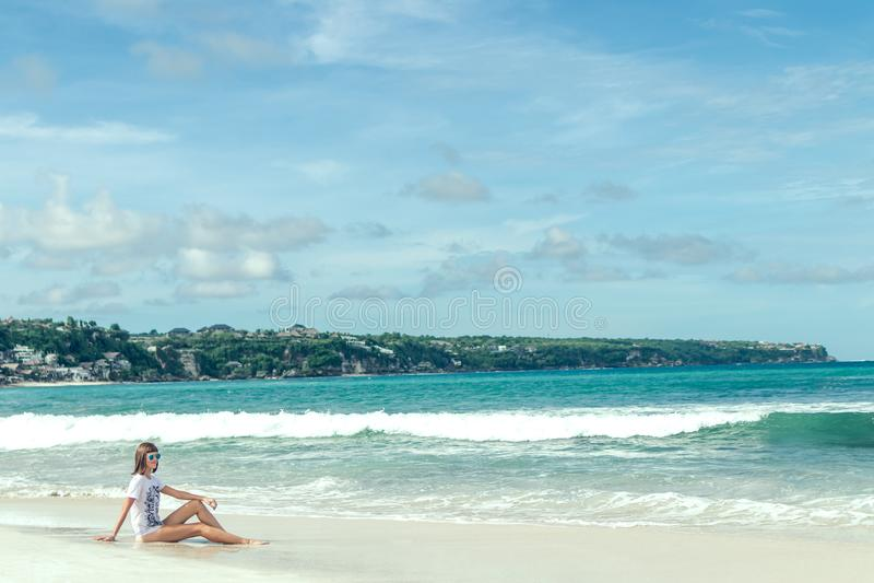Woman Sitting on Seashore stock image