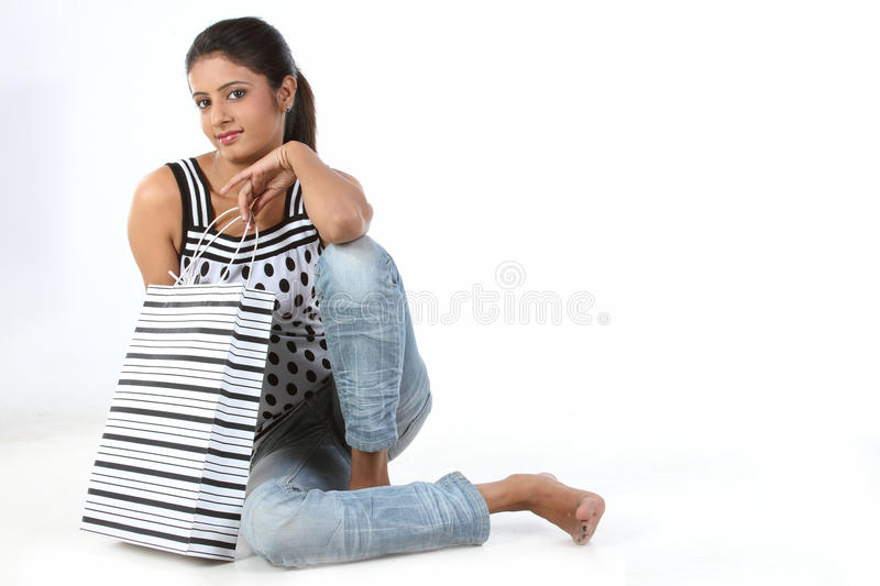 woman sitting with shopping bag royalty free stock photos