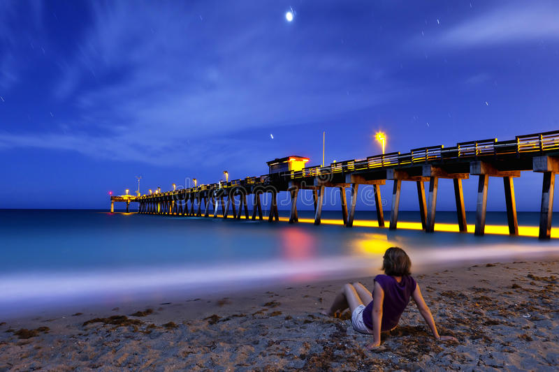 Download Woman Sitting On Shore At Night Stock Image - Image: 24264227