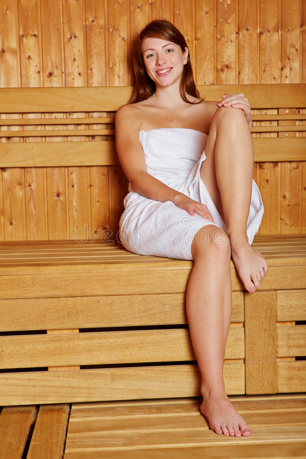 Woman Sitting Smiling In Sauna Royalty Free Stock Images