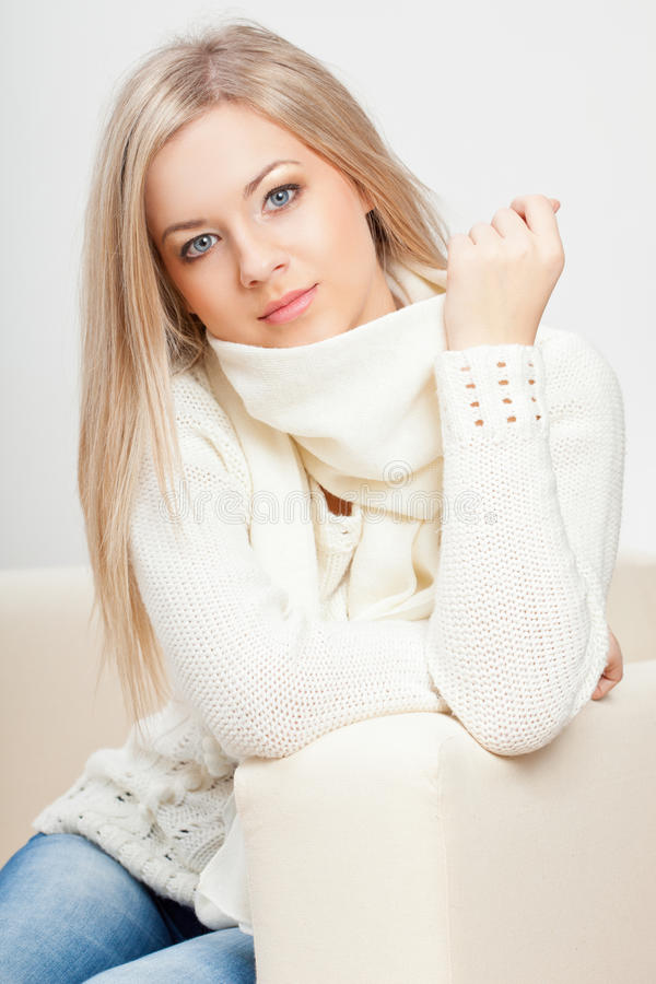 Woman sitting on sofa stock image
