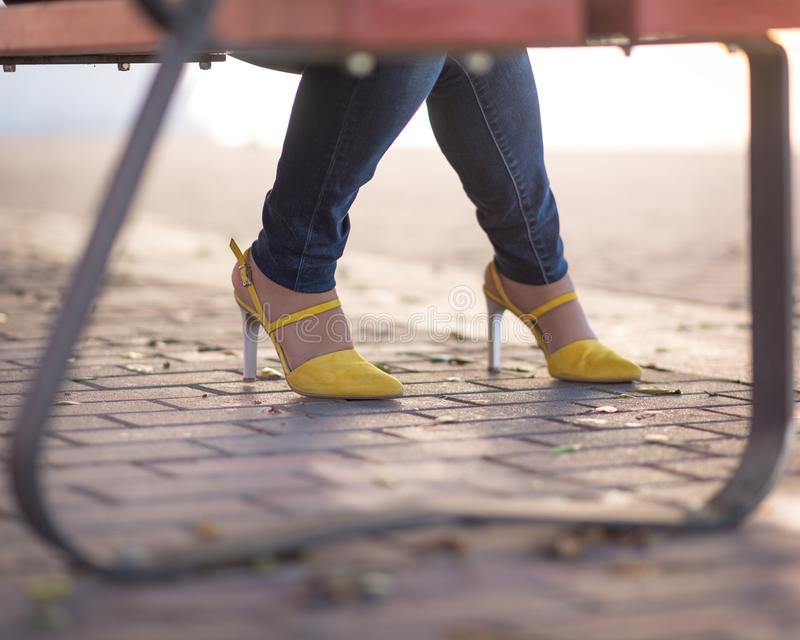 Pretty yellow shoes royalty free stock photo