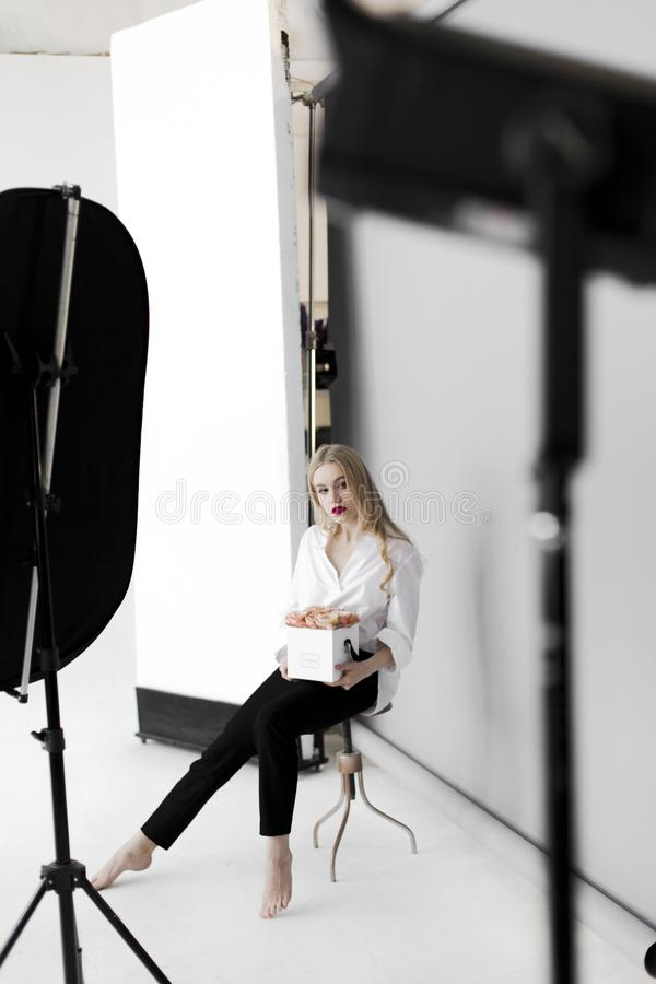 Woman Sitting on Stool While Holding Box stock photography