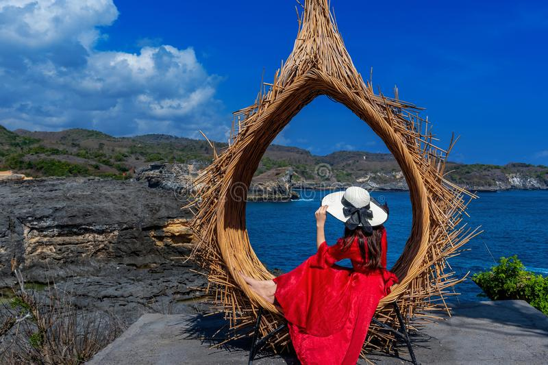 Woman sitting on straw nests in Bali island, Indonesia. Woman sitting on straw nests in Bali island, Indonesia stock images