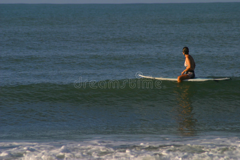 Woman Sitting On Surfboard Stock Photography