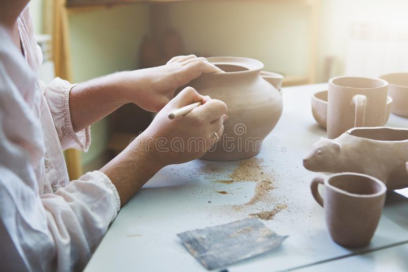 Woman sitting at the table making pottery royalty free stock photos