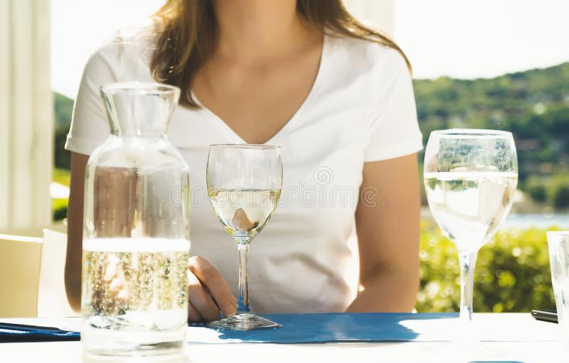 Woman with white glass of wine royalty free stock photos