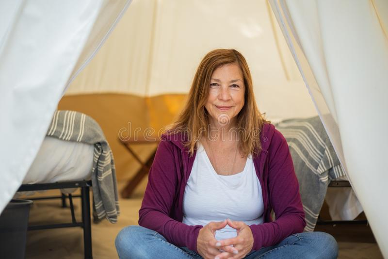 Woman sitting in tent royalty free stock photography