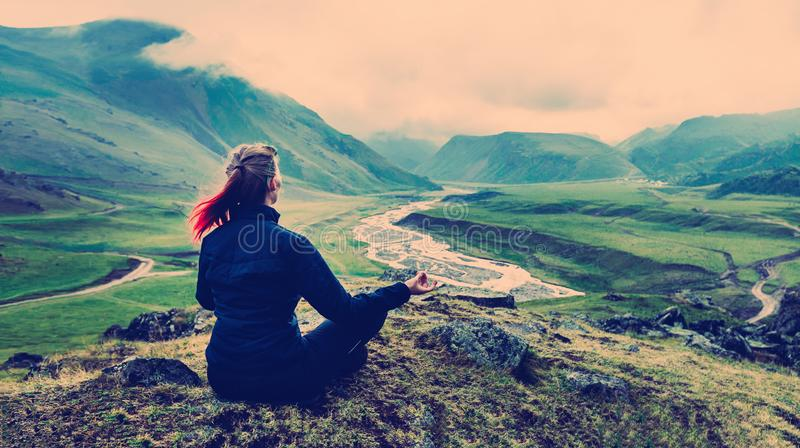 Woman Sitting On The Top And Meditates Vintage Toned Instagram stock images