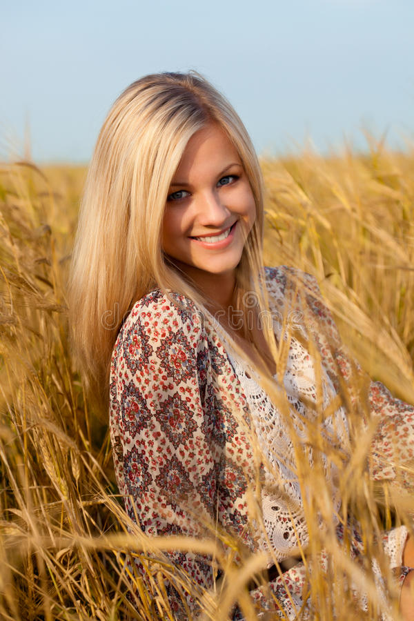 Download Woman Sitting On Wheat Field Stock Photo - Image of hair, blond: 21520178