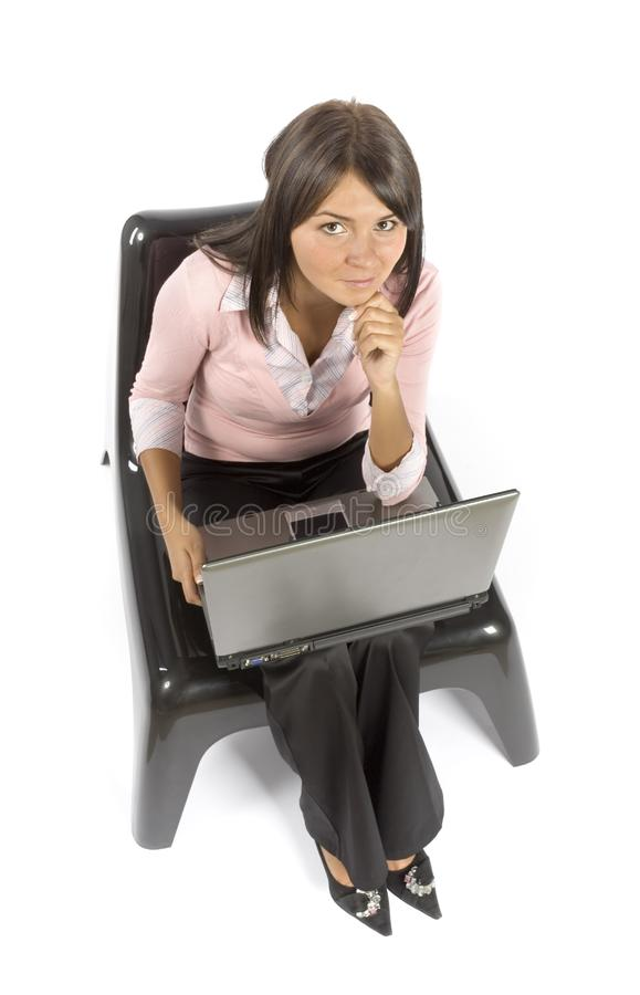 Woman sitting; working computer stock images