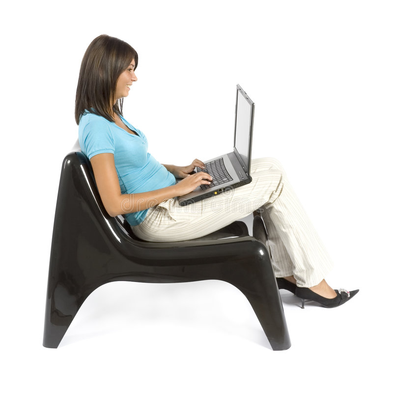 Woman sitting; working computer royalty free stock images