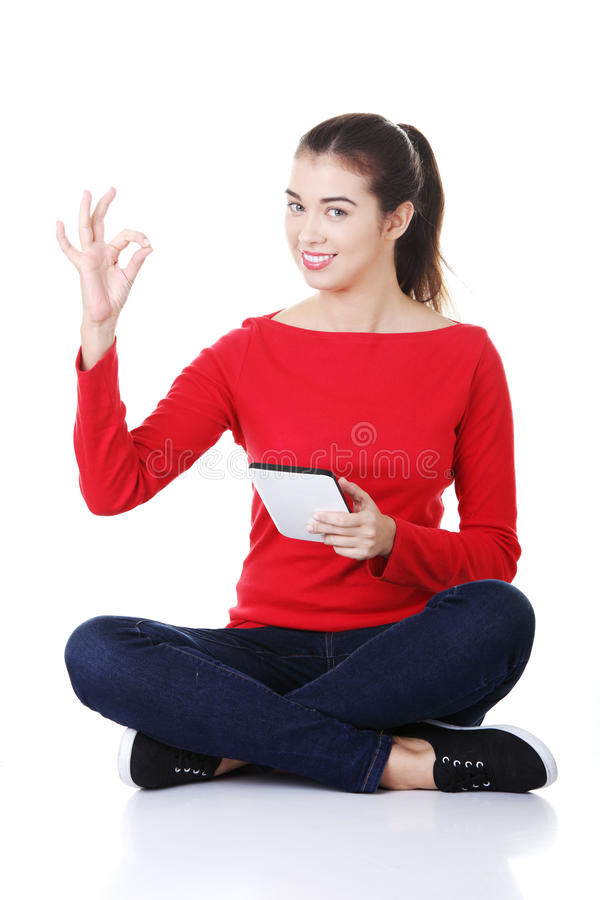 Woman Sitting And Working On Tablet Computer, Stock Photo