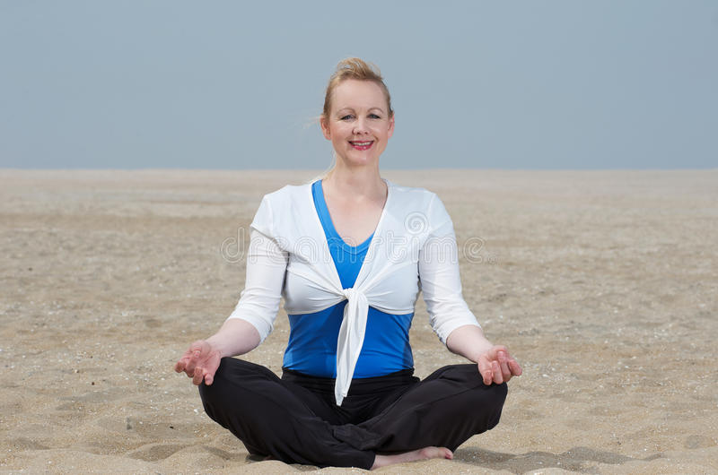 Download Woman Sitting In Yoga Position At The Beach Royalty Free Stock Photography - Image: 32625957