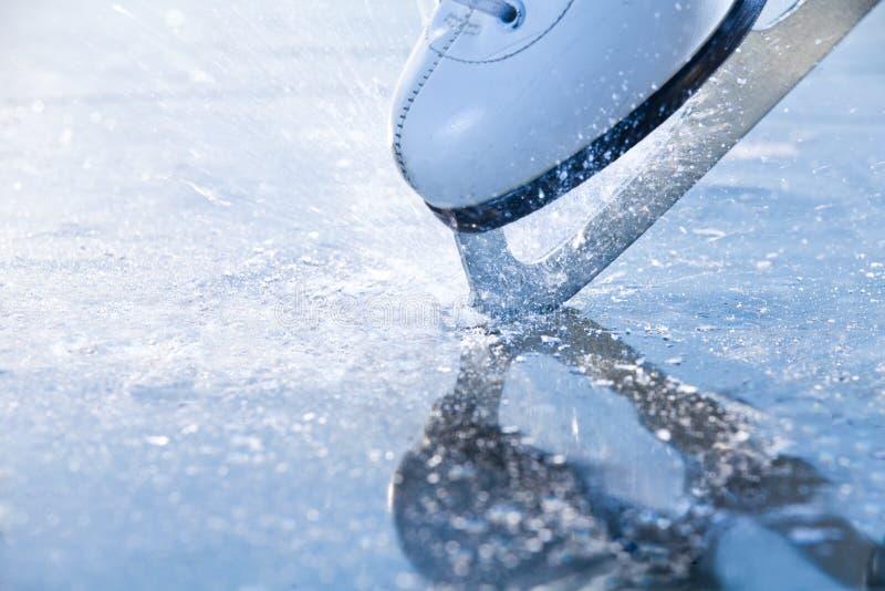 Woman skates braking ice, frazil royalty free stock photography