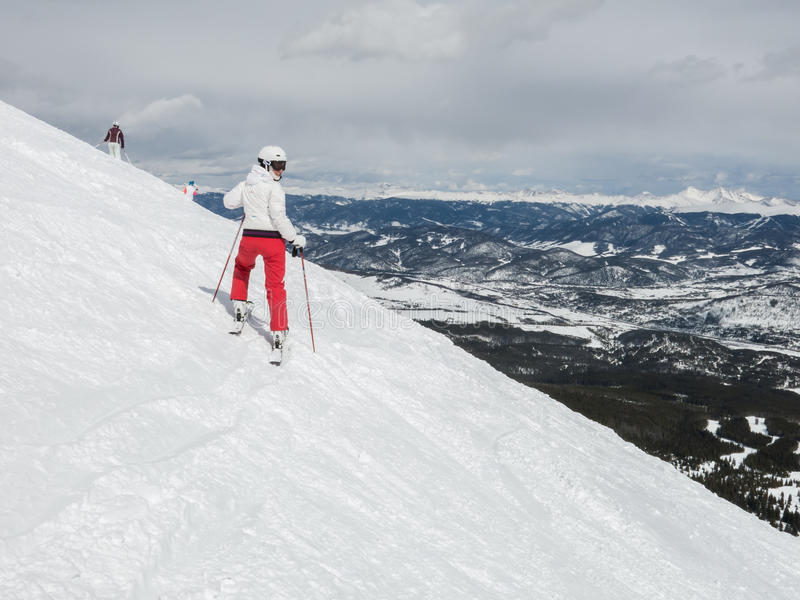 Woman skier ready for run down the hill royalty free stock photo