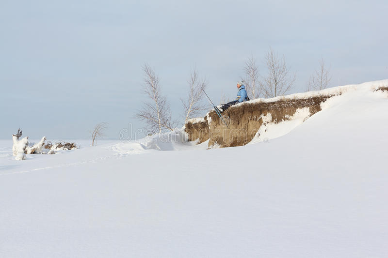 The woman the skier sitting on the bank of the river royalty free stock images