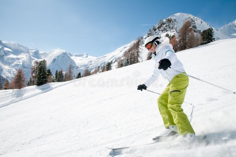 Woman skiing downhill royalty free stock image