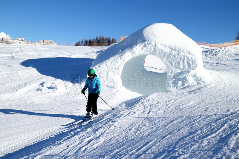 Woman is skiing on a sunny day. In the dolomite royalty free stock photos