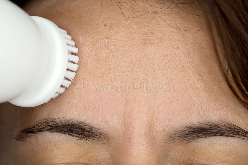 Woman with skin cleaning device royalty free stock images