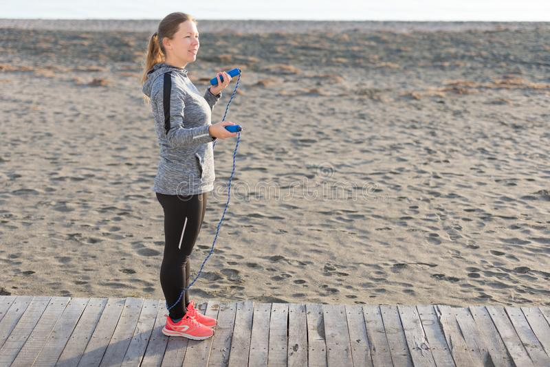 Woman skipping with jumping rope stock images