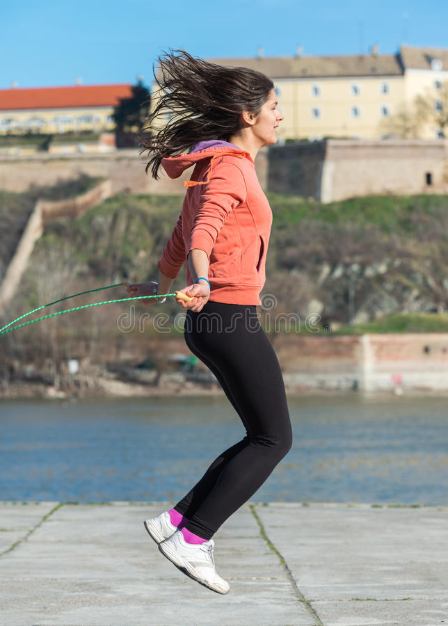 Woman with skipping rope. Cute woman with skipping rope stock photos