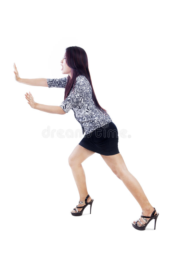 Woman with skirt push something - isolated royalty free stock photo