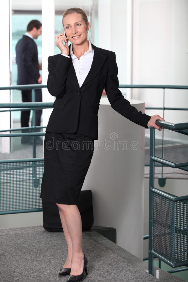 Woman in a skirt suit
