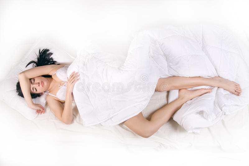 Woman sleep in bed royalty free stock photo