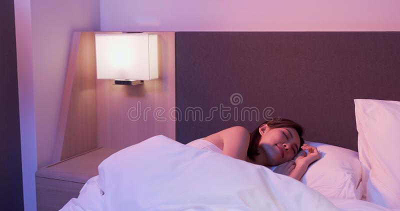 Woman sleep well on bed stock image