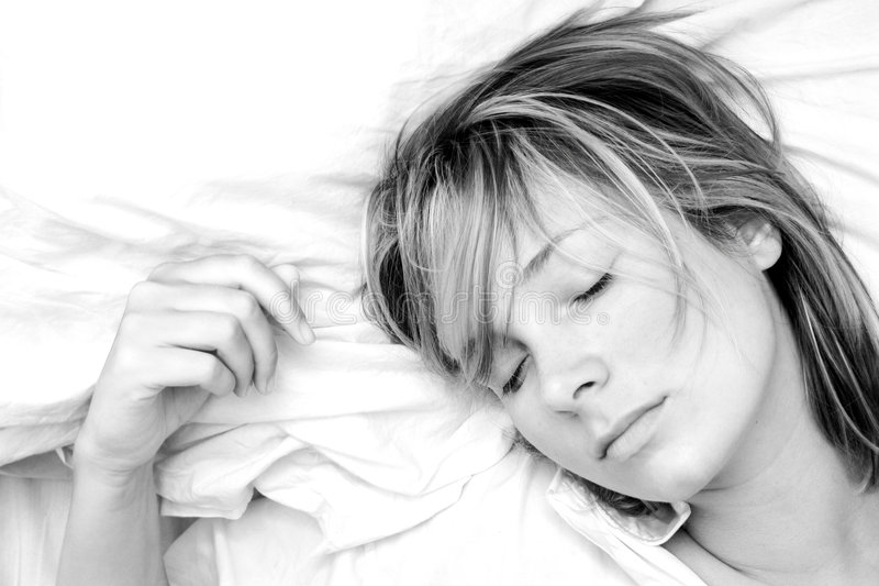 Woman Sleeping. High key black and white image of pretty girl sleeping peacefully stock photos