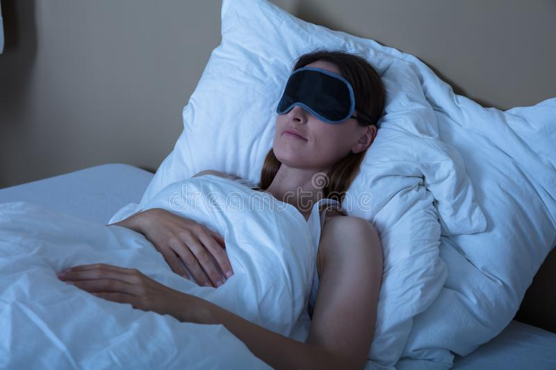 Woman Sleeping In Bed With Eye Mask stock image