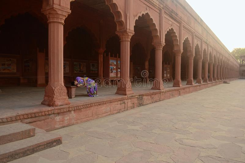 Woman is sleeping on a bench in Taj Mahal complex stock images